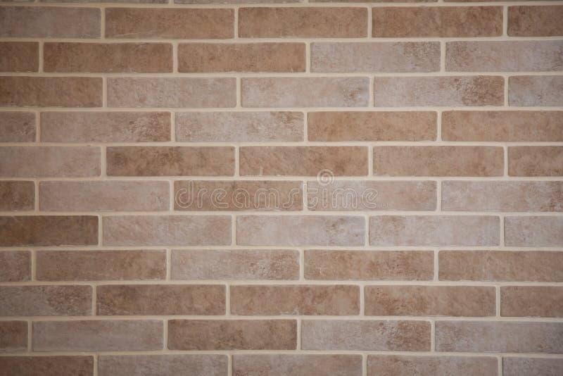 Priorit? bassa di struttura del muro di mattoni Un vecchio fondo marrone del muro di mattoni Vecchia foto arancio dettagliata del fotografie stock libere da diritti