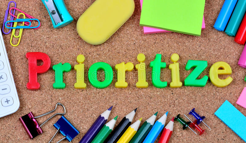 Prioritize word on cork background. Closeup royalty free stock photo