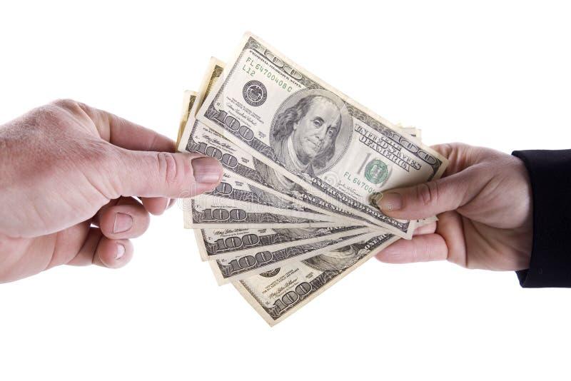 Prise d'une poignée d'argent photo libre de droits