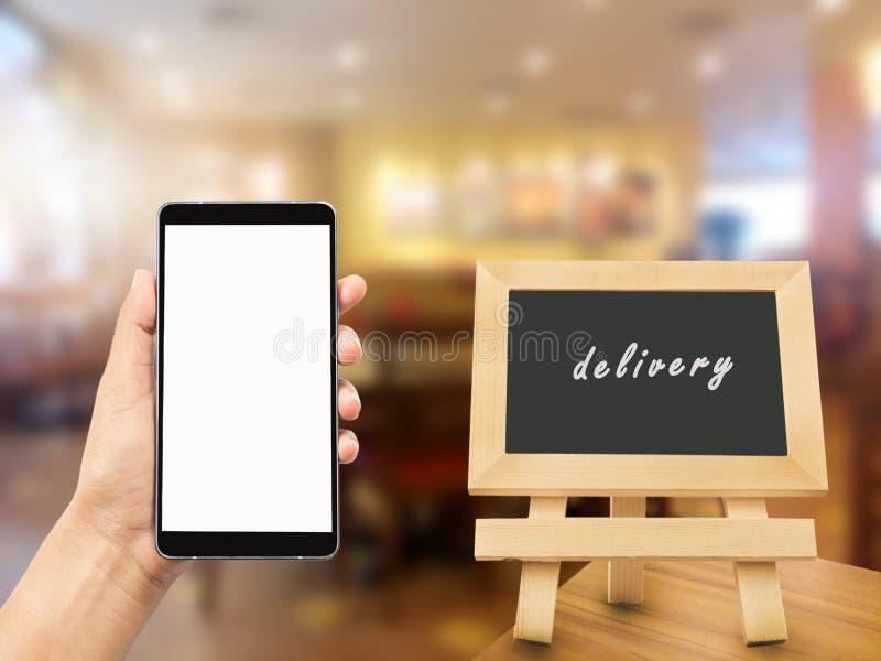 Prise de main de femme et mobile de contact image libre de droits