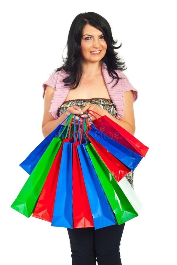 Prise heureuse de femme beaucoup de sacs à provisions colorés images libres de droits