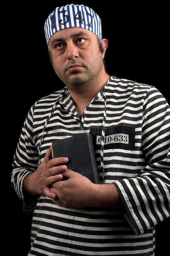 Prisioneiro com livro fotografia de stock royalty free