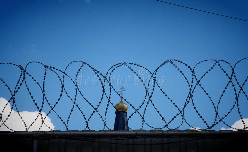 Prison fence with barbed wire stock photo