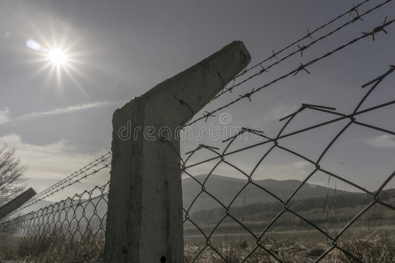 Prison fences with sky. Close up view of fences and wires royalty free stock photography