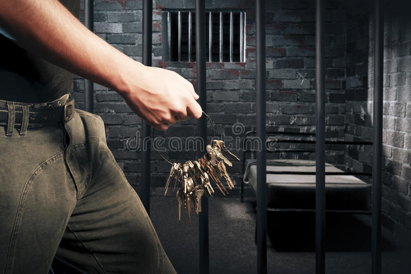Prison guard with keys stock photos