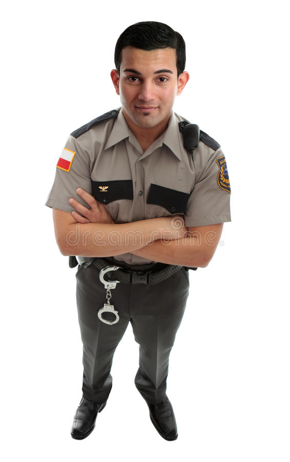 Prison Guard Warden or Policeman. A male prison guard warden or policeman in uniform with duty belt and radio unit. Standing with arms crossed and looking up stock photos