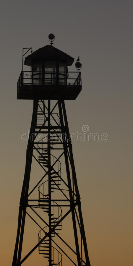 Prison guard watch tower at dusk. A prison guard watch tower at dusk on the Island of Alcatraz royalty free stock photo