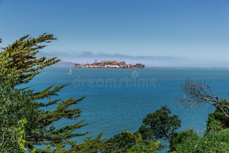 The prison and island of Alcatraz in San Francisco Bay on a rare fog free day royalty free stock photo