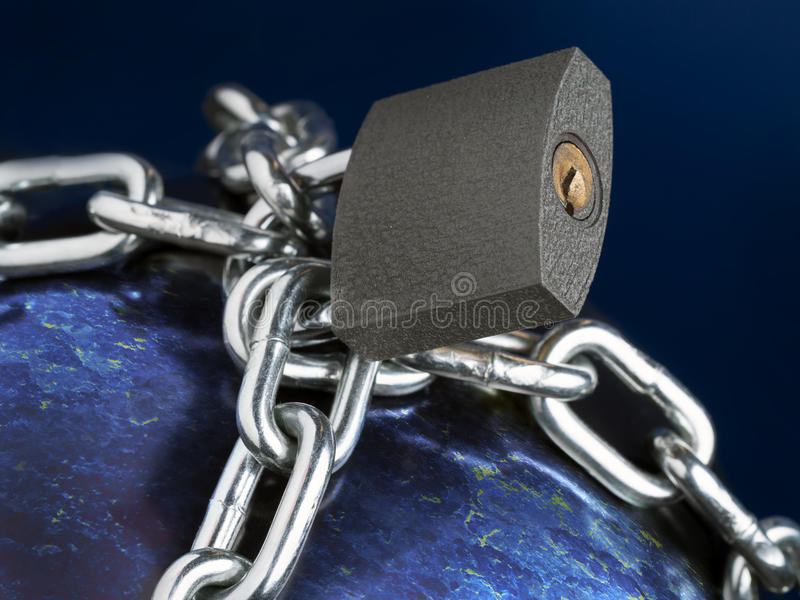 Prison Planet Earth. Computer generated planet Earth chained as metaphor of Prison Planet stock photography