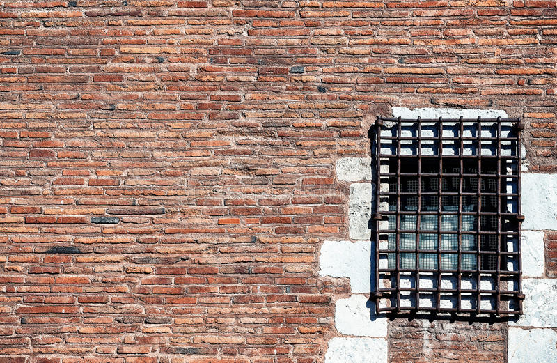 Prison red brick wall. With window royalty free stock image