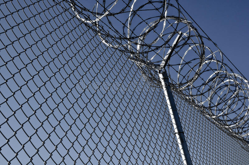 Prison Security Fence. Security Fence used at a Prison Facility used to protect from identity theft and fraud royalty free stock photography