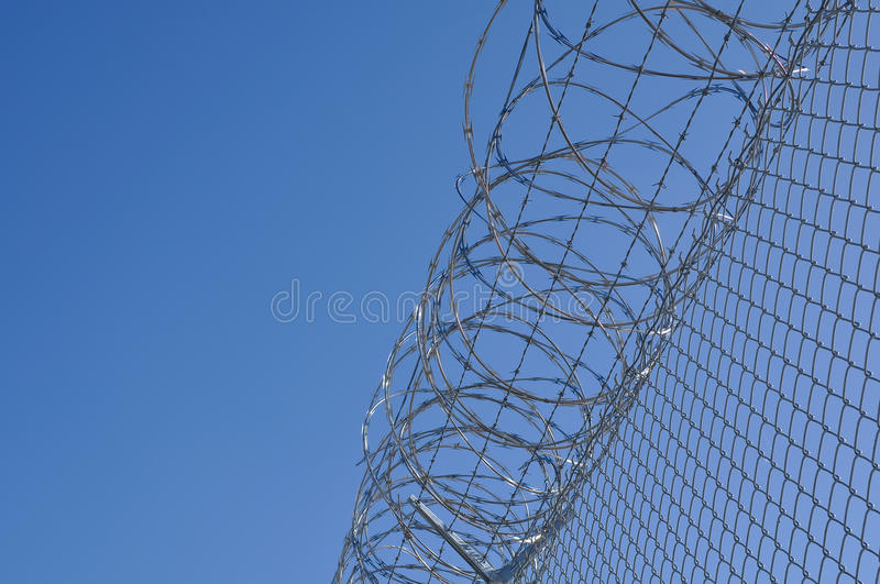 Prison Security Fence. Security Fence used at a Prison Facility with room for text to protect against identity fraud and computer hackers stock photography