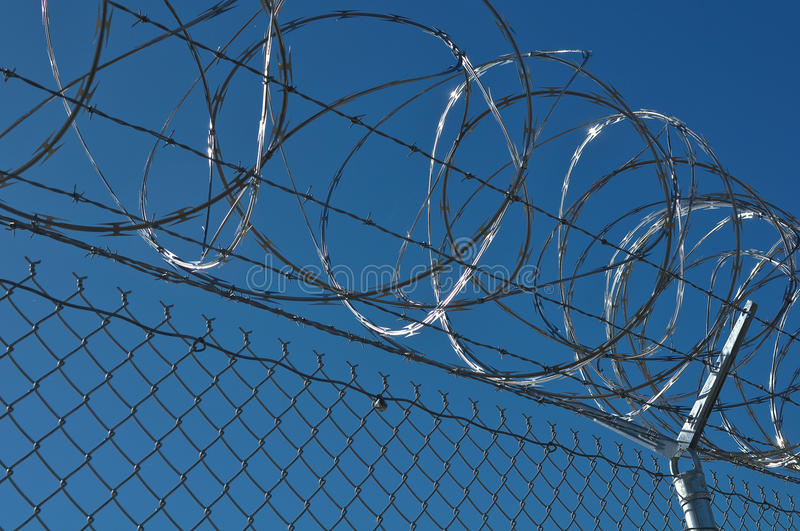 Prison Security Fence. Security Fence used at a Prison Facility used to protect from identity theft and fraud stock photo
