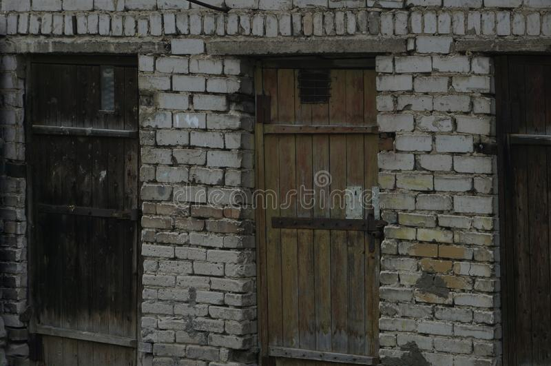 Prison wall and doors a lot of royalty free stock photos