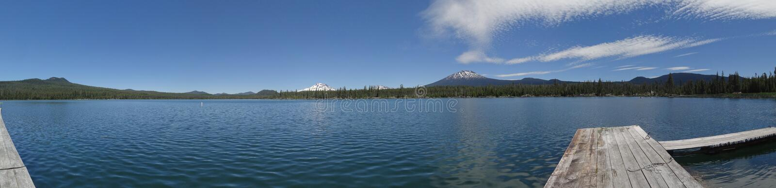 Pristine Lava Lake at the foot of Mt. Bachelor. Oregon - Lava Lake - A sweeping view of the lake, with Mt. Bachelor and the Three Sisters in the distance. July royalty free stock image