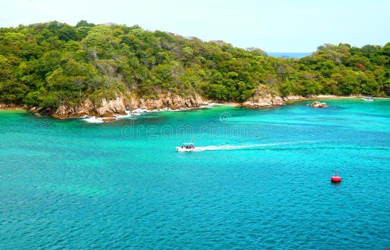 Pristine Ocean and Forest. Santa Cruz Bay, Huatulco, Mexico. Sunny day stock photography