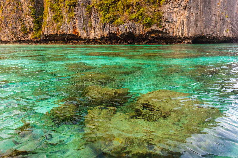 Pristine shallow waters. Maya Bay is sheltered by high cliffs on three sides with several beaches with soft white sand and exotic fish in clear water royalty free stock images