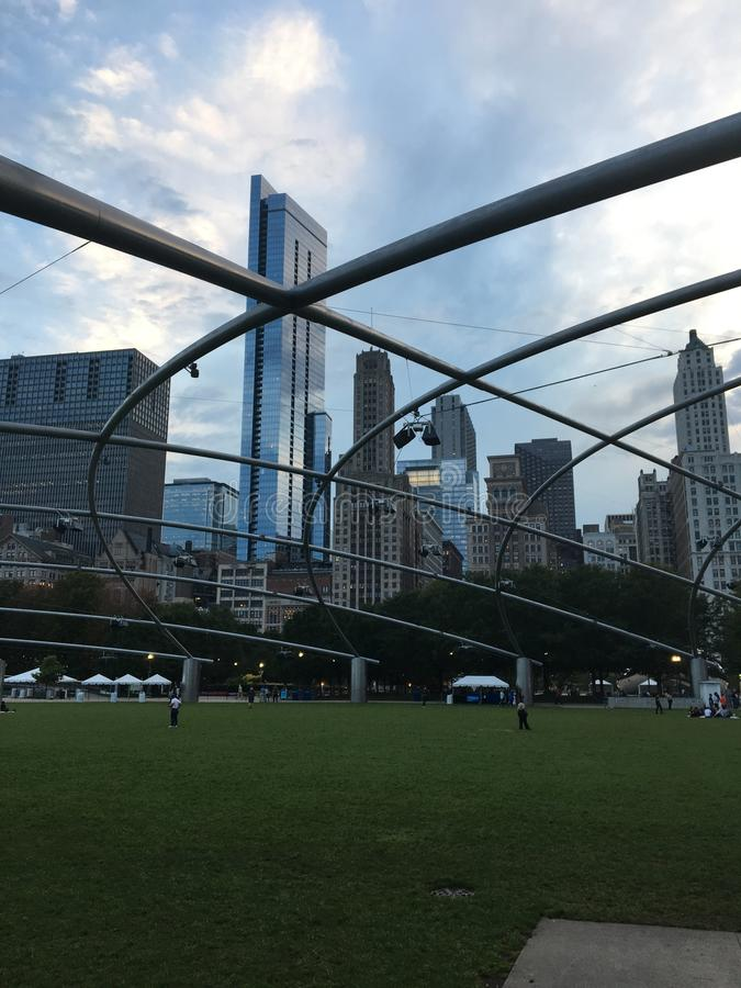 Pritzger Theater, Millennium Park, Chicago. The arching metal beams of the Pritzker Theater in Millennium Park in Chicago soar over the grass audience area royalty free stock image