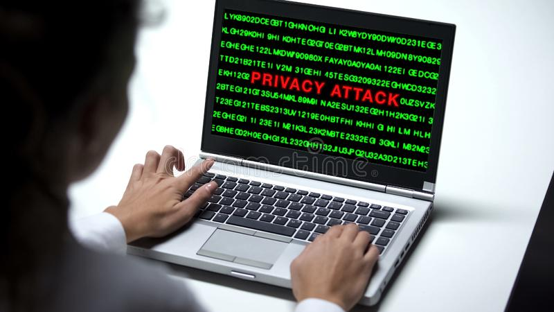 Privacy attack on laptop computer, woman working in office, cybercrime, close up stock image