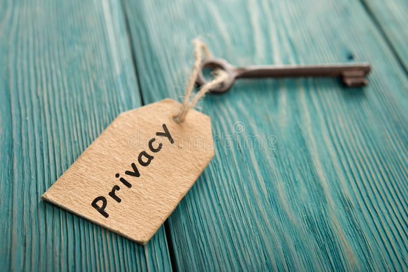 privacy concept - vintage key with tag with inscription royalty free stock photos