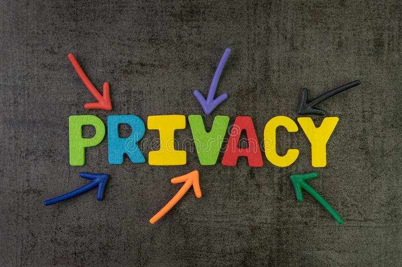Privacy, GDPR or General Data Protection Regulation concept, col. Orful arrows pointing to the word PRIVACY at the center of black chalkboard wall, important of stock photo