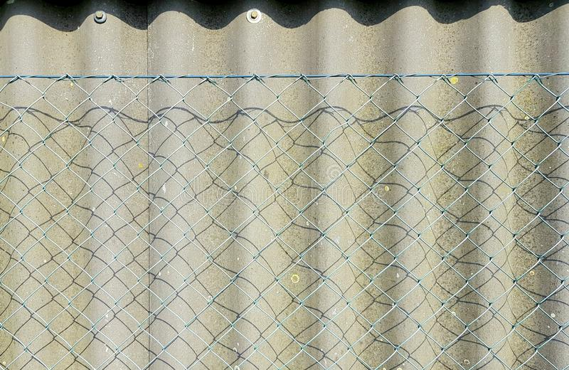 Double protection fence. Background with fence symbolizing privacy protection. Privacy protection with double fence. Fence backdrop royalty free stock images