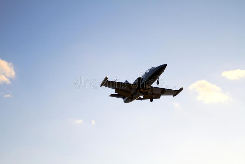 Private Aircraft landing on a blue sky background stock images