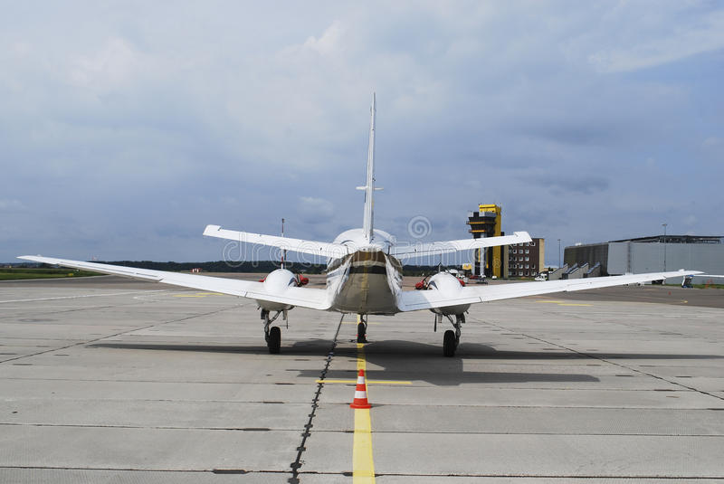 Private airplane. Standing on the apron at international airport stock image