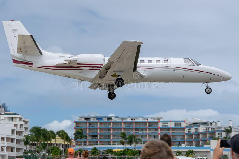 Private business jet aircraft preparing to land royalty free stock images