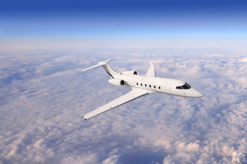 Private business jet airplane flying on a high altitude royalty free stock photo