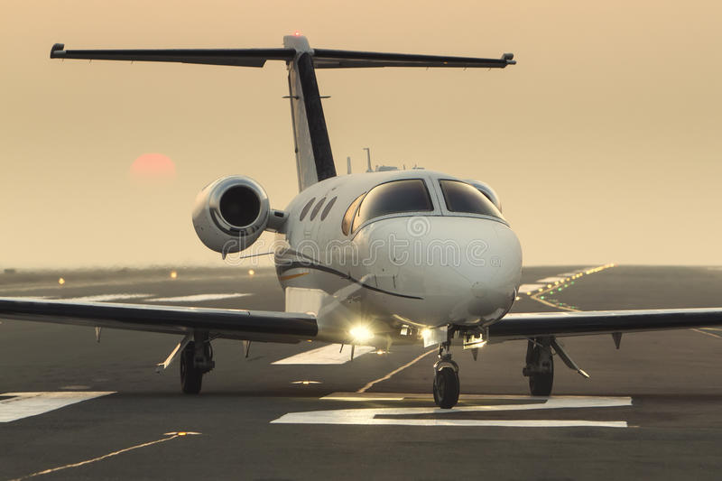 Private business jet on the runway royalty free stock images
