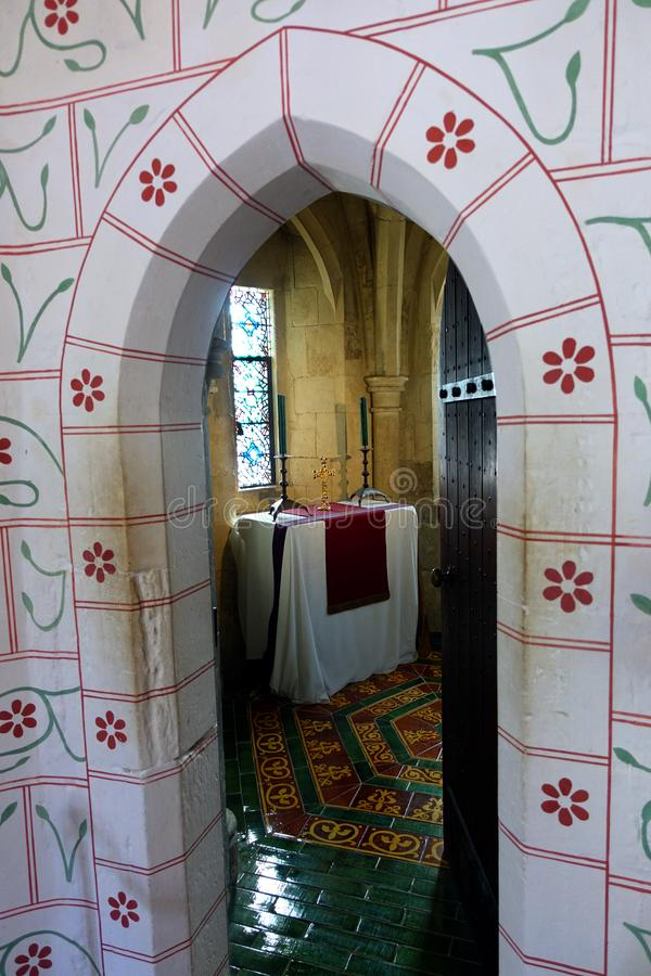 Private Chapel of Prayer in Tower of London. Looking through a decorated doorway into a small private chapel located within the Tower of London royalty free stock image