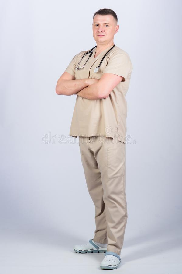 Private clinic. Doctor career. Man doctor stethoscope physician uniform. Medicine and health care. Treatment and. Prevention. Guy experienced doctor beige royalty free stock photo