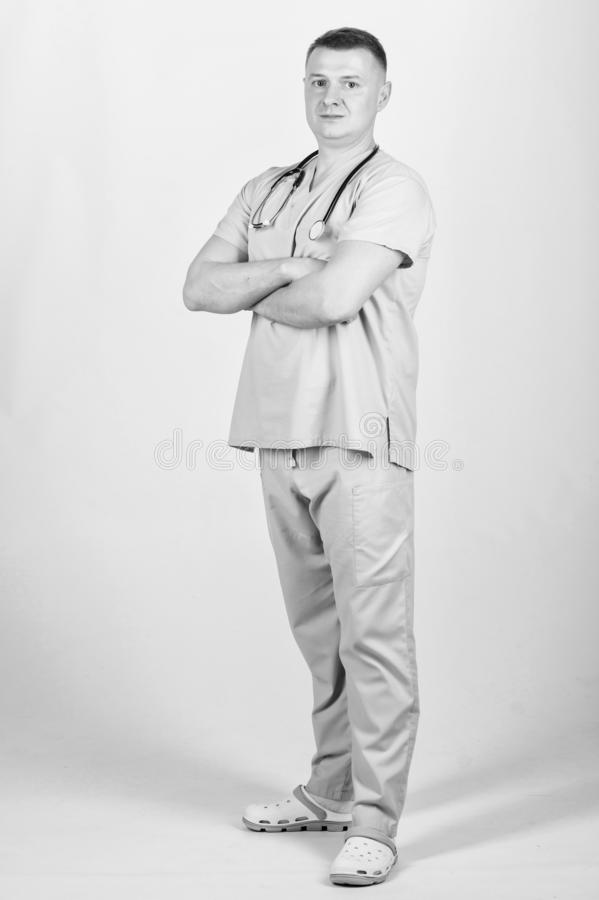 Private clinic. Doctor career. Man doctor stethoscope physician uniform. Medicine and health care. Treatment and. Prevention. Guy experienced doctor beige stock photography