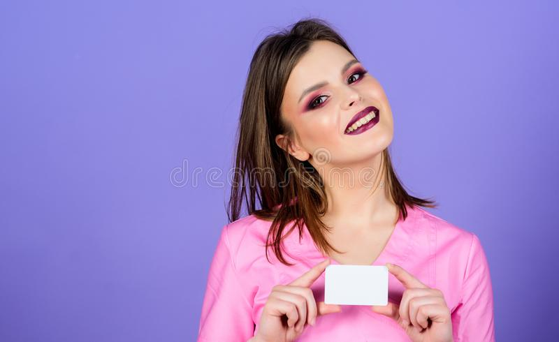 Private clinic. Woman pretty doctor wear uniform. Girl doctor hold business card copy space. Medical treatment. Recommendations. Prescribed by doctor. Health royalty free stock photography
