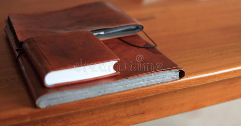 Private documents. Lying on a wooden desk royalty free stock image