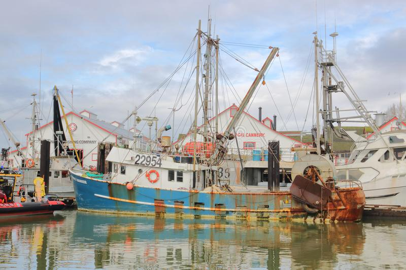 Private Fishing Boats in Canada. Small, privately owned fishing boats are moored in a marina in Steveston, a suburb of Richmond, BC, on Canada`s west coast on stock photos