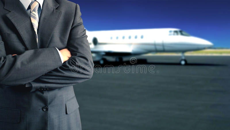 Private jet. Businessman standing in front of jet royalty free stock photos