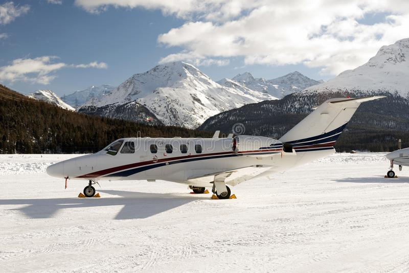 A private jet is ready to take off in the airport of St Moritz Switzerland in winter stock image