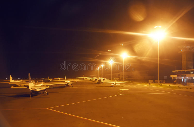 Private jets in airport. Night photography stock photos