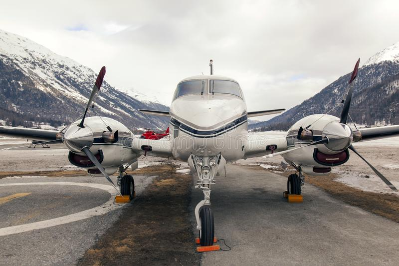 Private jets and a helicopter in the airport of St Moritz Switzerland stock photos