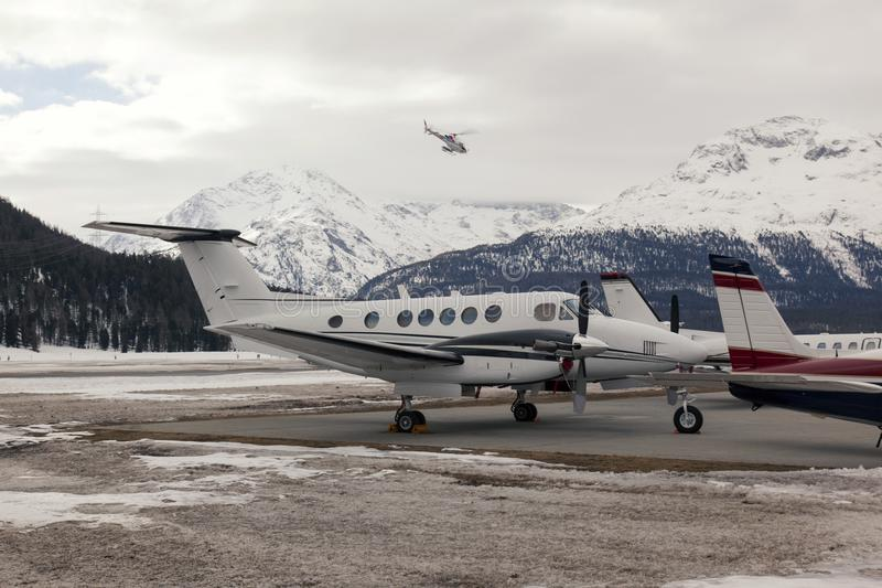 Private jets and a helicopter in the airport of St Moritz Switzerland.  stock image