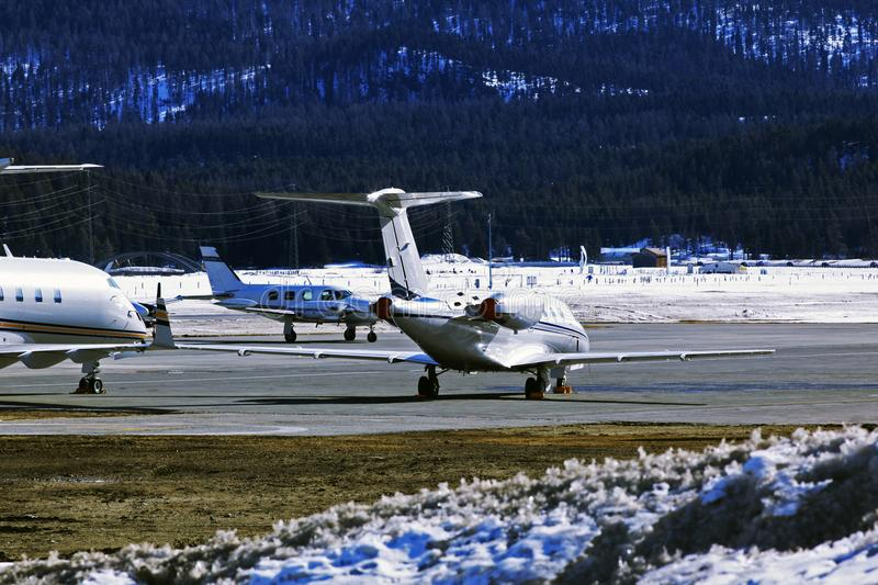 Private jets and planes in the airport of St Moritz Switzerland in the alps.  royalty free stock images