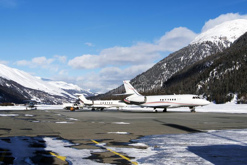 Private jets and planes in the airport of St Moritz Switzerland in winter time royalty free stock photo