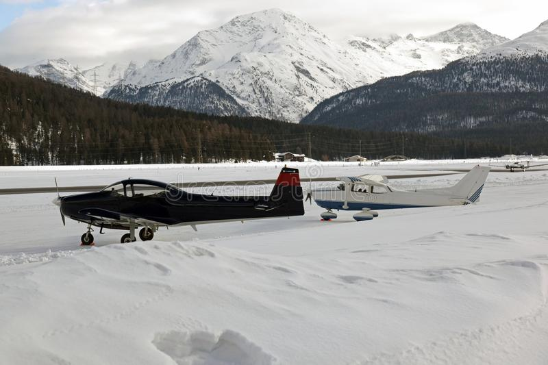 Private jets, planes and helicopters in the airport of St Moritz Switzerland in the alps stock photos
