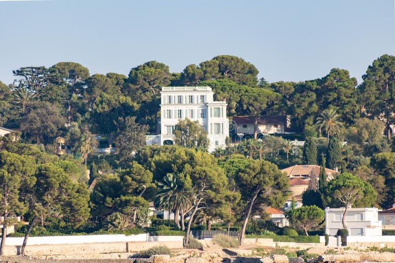 Private mansion, art deco architecture in Cap d`Antibes, Provence luxury property, French Riviera, France royalty free stock images