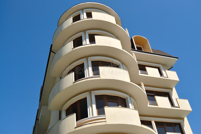 Private multi-storey hotel. With a round exit to the balcony, on a background of blue sky stock photo