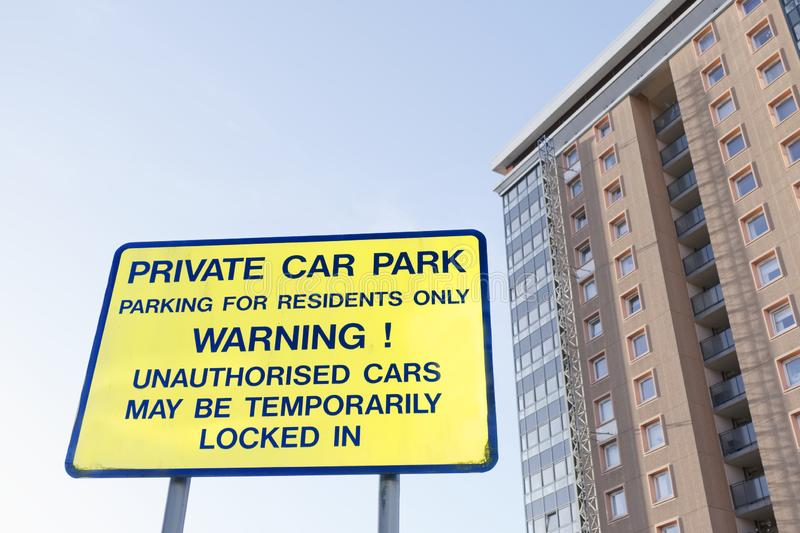 Private parking residents only sign and flats tower block. Uk stock photos
