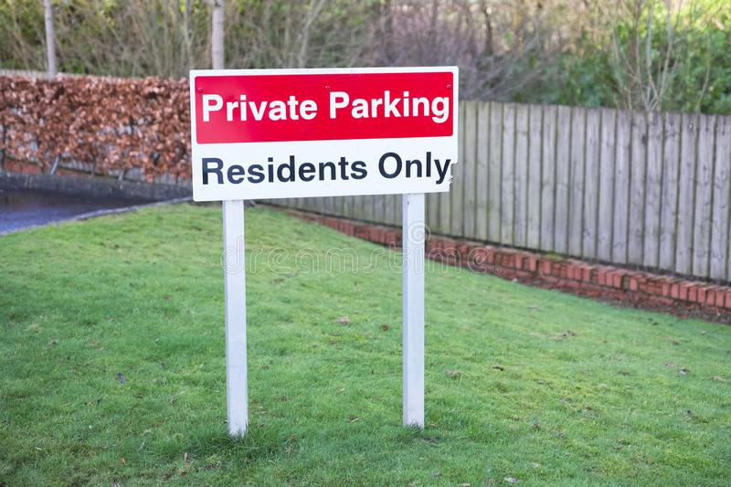 Private parking residents only sign and flats tower block. Private parking residents only sign uk royalty free stock photography