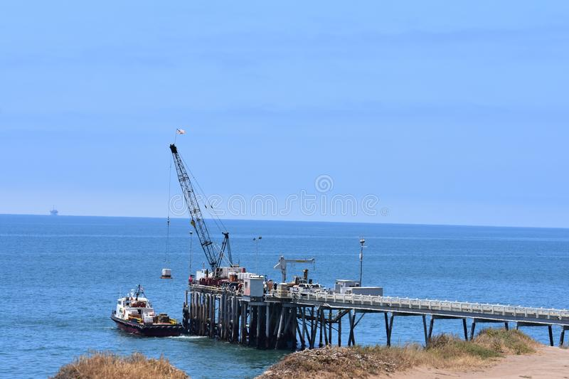 Chevron Oil Pier Carpinteria California, 5. A private pier to get equipment and personal back-and-forth to the off shore oil rigs, it is off limits to public stock photo